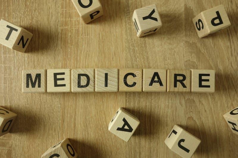 Parola Medicare da blocchi di legno immagini stock libere da diritti