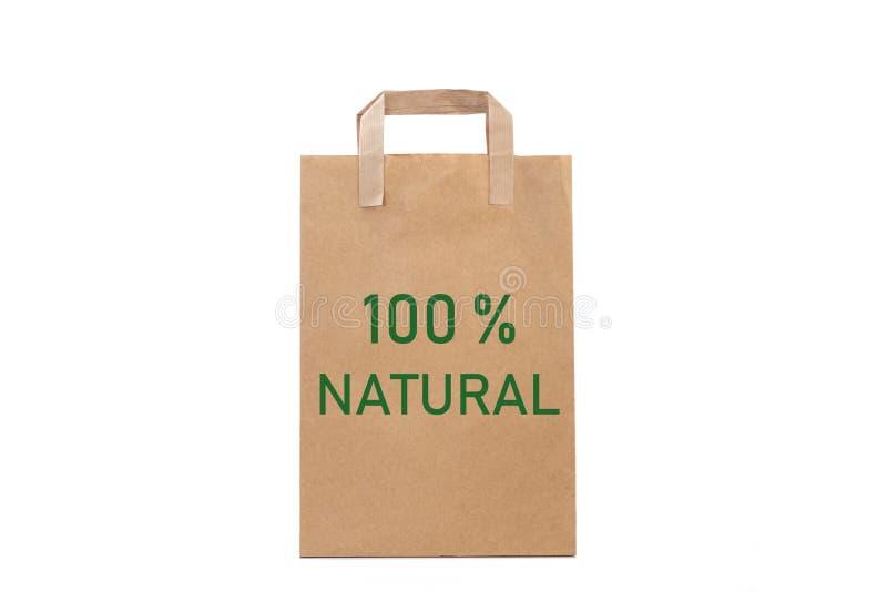 parola naturale di 100% scrivere in un sacco di carta immagini stock