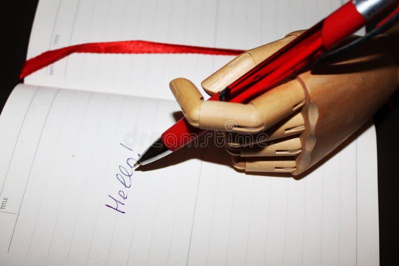Parola scritta di legno della mano ciao immagine stock libera da diritti