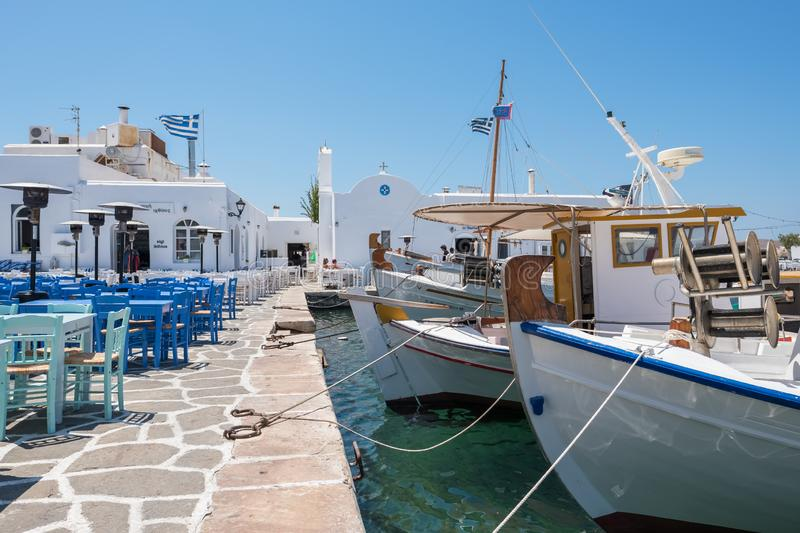 Typical Greek taverna tables in picturesque Naoussa town, Paros island, Cyclades, Greece royalty free stock photography