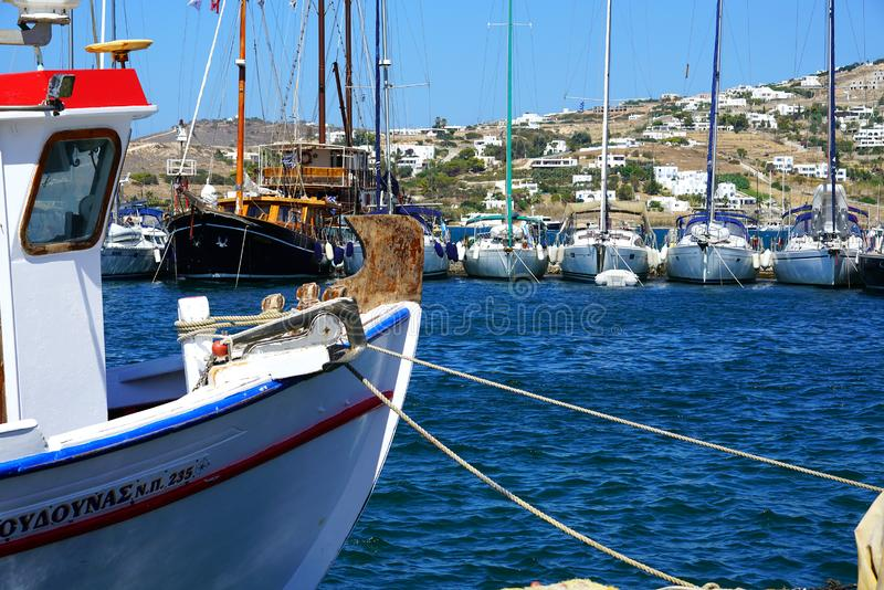 PAROS, GREECE, SEPTEMBER 18, 2018, Beautiful boats of various types in the port. Of Parikia vacations tide porto wood harbor vessel sea island color pier water stock photo