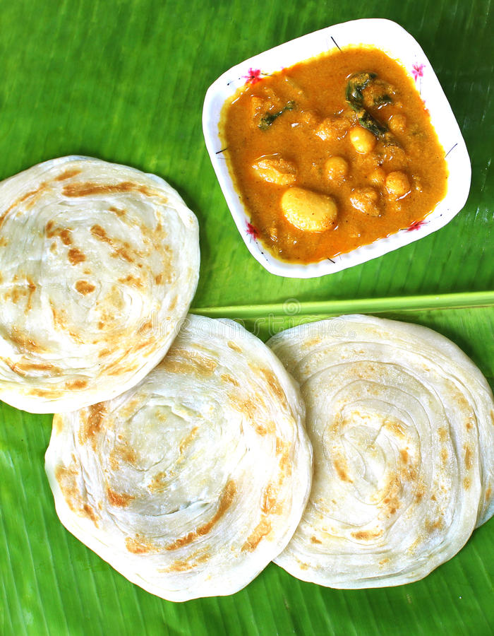 Parottas with kurma. (indian bread) on a leaf royalty free stock photography