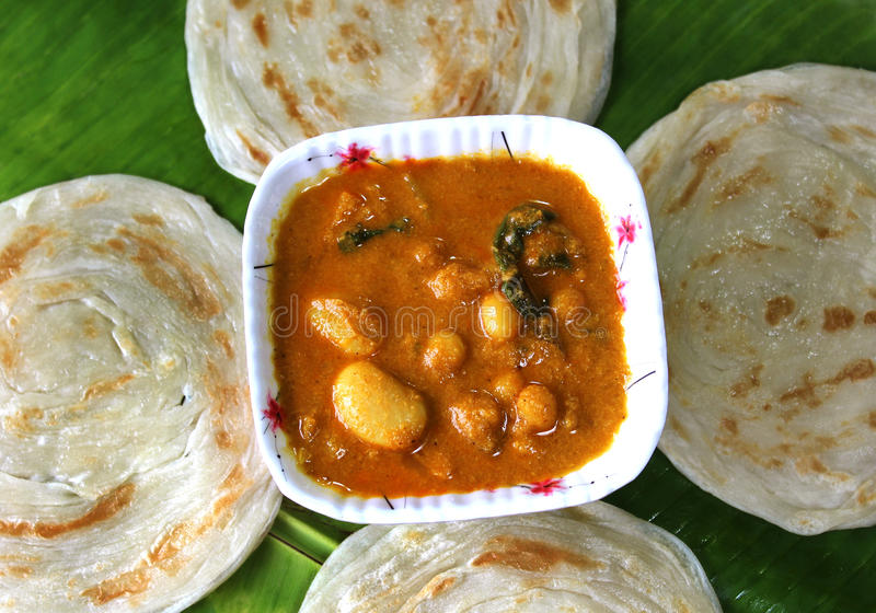 Parottas with kurma. (indian bread) on a plate stock images