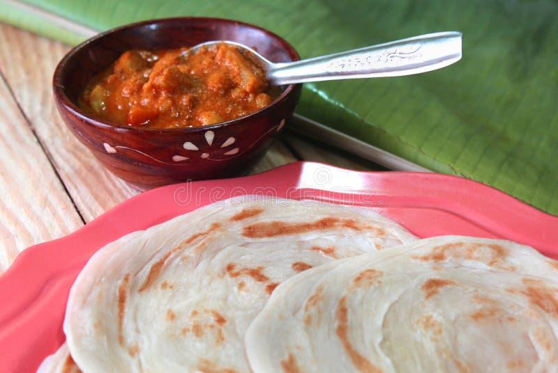 Parottas with kurma. (indian bread) on a plate stock photo