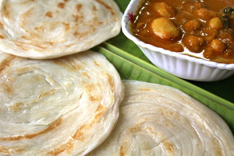 Parottas on the leaf. Parottas with kurma (indian bread) on a leaf royalty free stock image