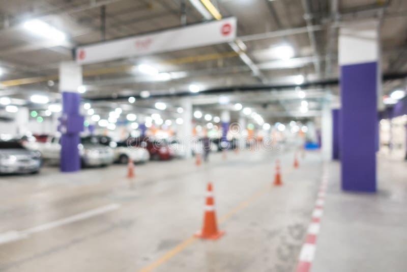 Parque de estacionamento abstrato do carro do borrão foto de stock
