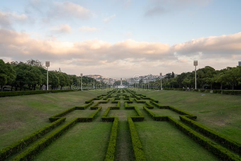 Parque Eduardo VII public park and hedge decorations in center square, with Libson and Tagus river in background stock images