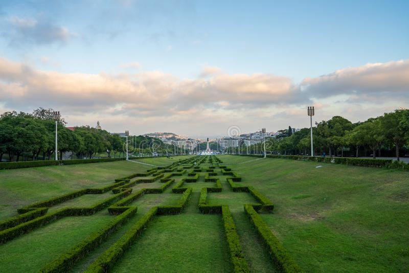 Parque Eduardo VII public park leading to Marques de Pombal monument during dusk stock photo