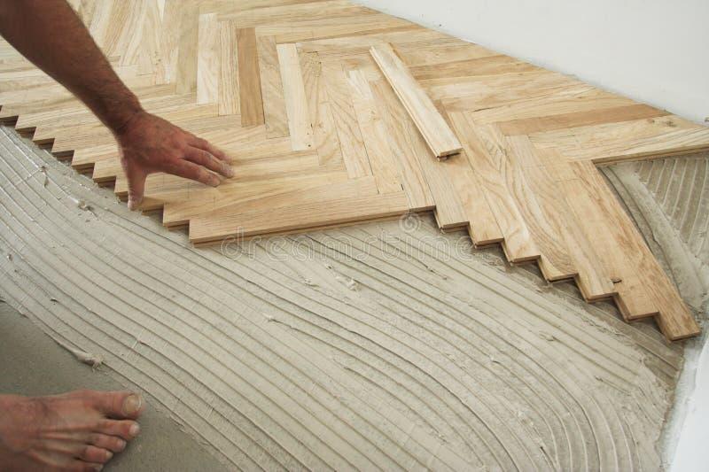 Parquet floor and carpenter stock photo