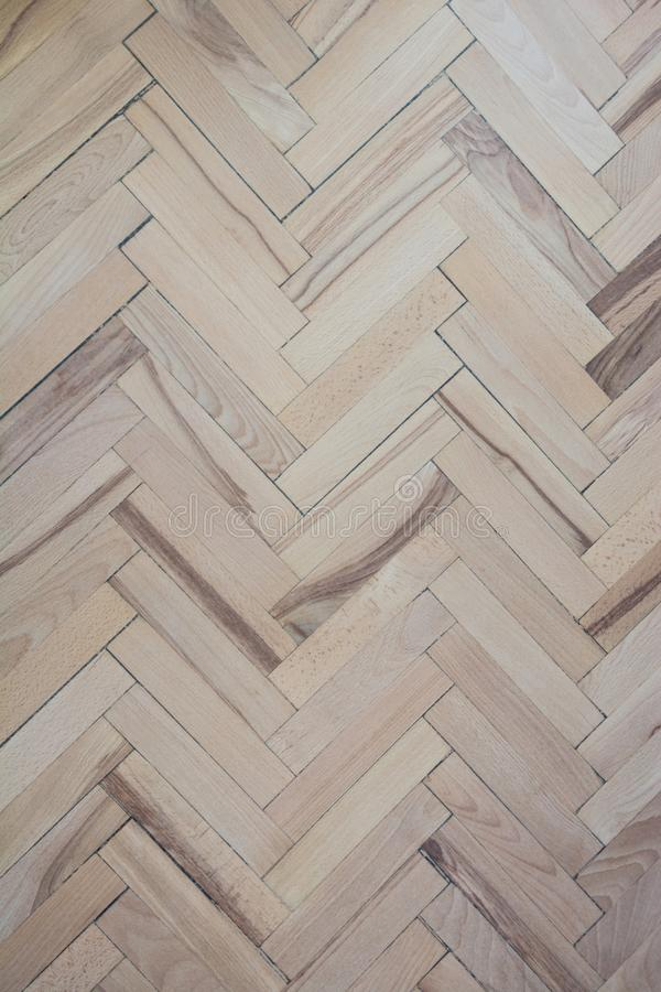 Parquet texture. Pattern. Natural old patterned herringbone of light and dark alternating parquet boards stock images