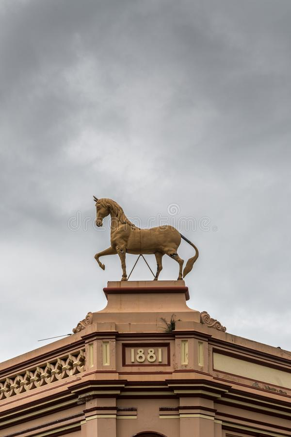 House with horse statue, Parramatta Australia. Parramatta, Australia - March 24, 2017: Horse statue on top of historic house along Macquarie Street intersection stock photos