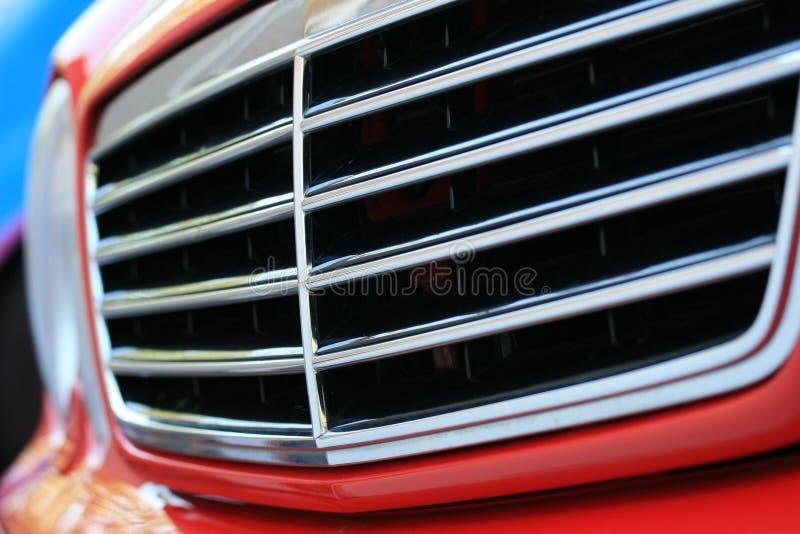 Parrilla roja del coche imagen de archivo