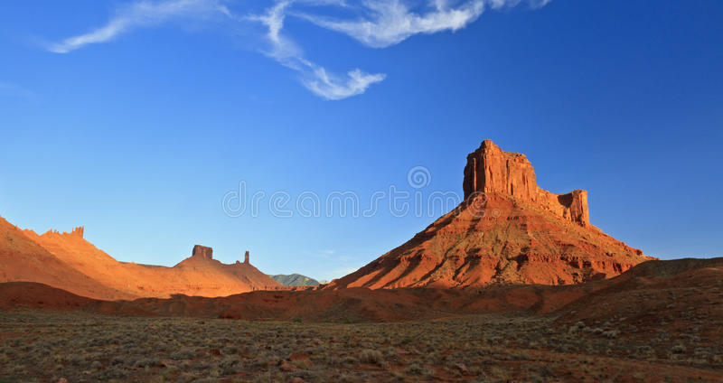Parriott Mesa and Castle Rock. Parriott Mesa rises from the desert with Castle Rock in the background in the desert near Moab, Utah stock image