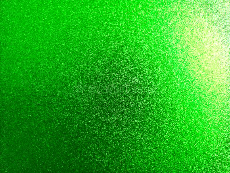 Parrot green coloured shiny background with light and dark light effects,attractive wallpaper. Parrot green coloured shiny background with light and dark light stock photos