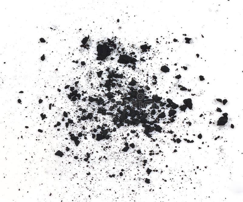 Partículas do carvão vegetal no fundo branco fotografia de stock royalty free