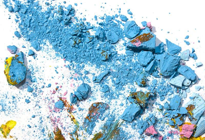 Partículas y pintura en colores pastel quebradas fotografía de archivo libre de regalías
