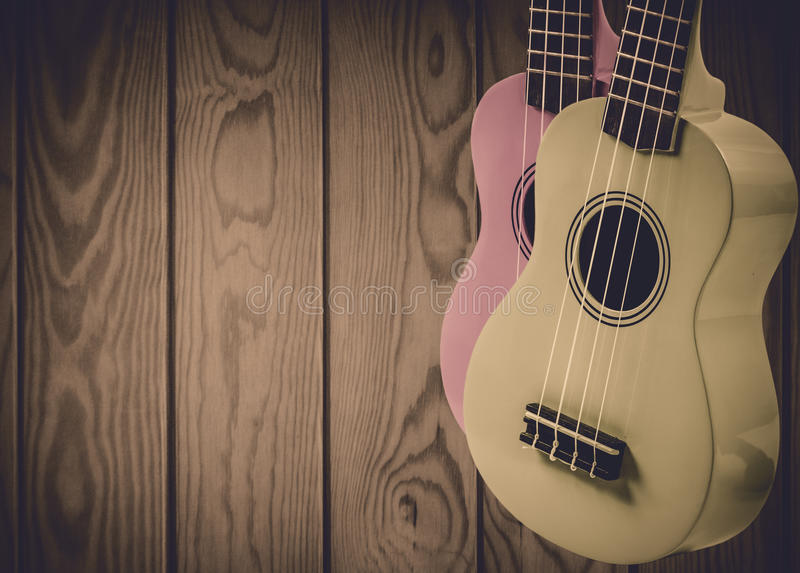 Part of an acoustic guitar on a blue wooden background. royalty free stock photo