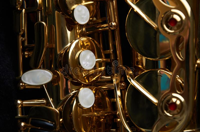 Part of alto sax with buttons and valves stock photos