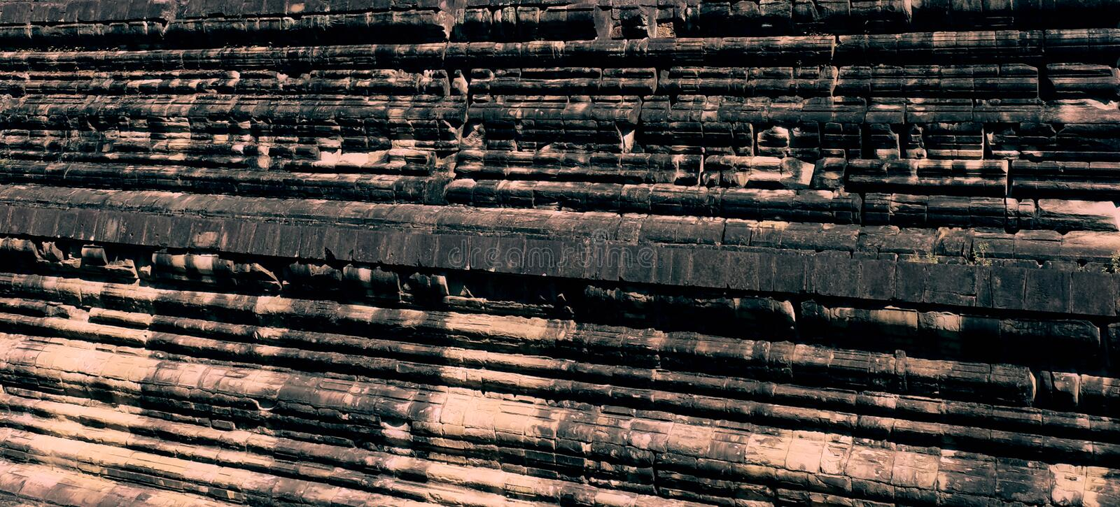 Part of the ancient stone wall. Antique stonework. Stone texture. Background stock image