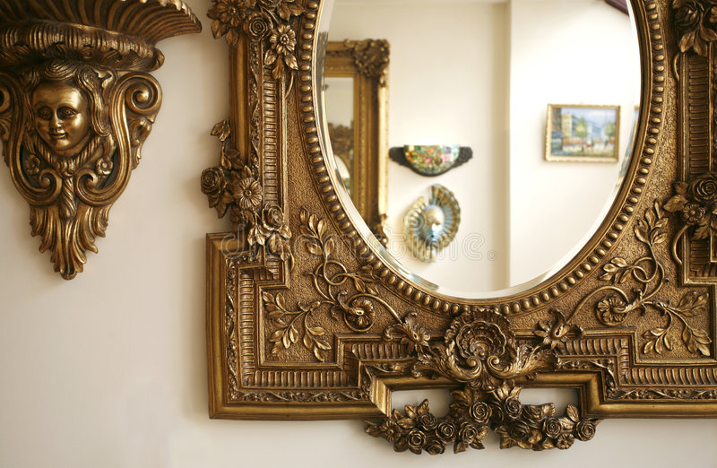 A part of an antique mirror. Frame in gold color stock photos