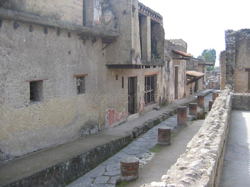 Part of an antique street of the ancient archaeological city of Ercolano. Italy stock photography
