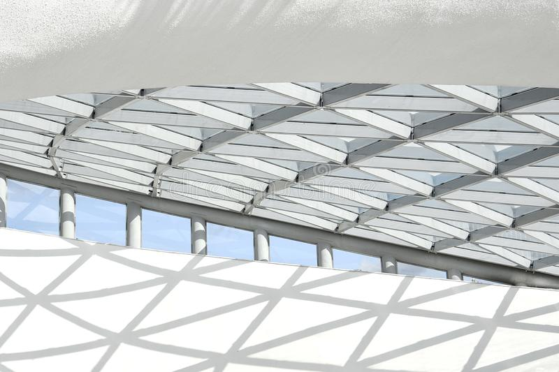 Part of the architectural structure consisting of a metal structure in the form of rhombuses royalty free stock photography