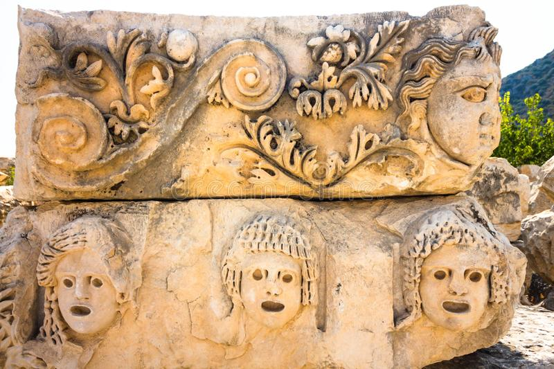 Part of the architecture of the ancient amphitheater. The architecture is located on the territory of modern Turkey. Several faces playing certain roles are stock images