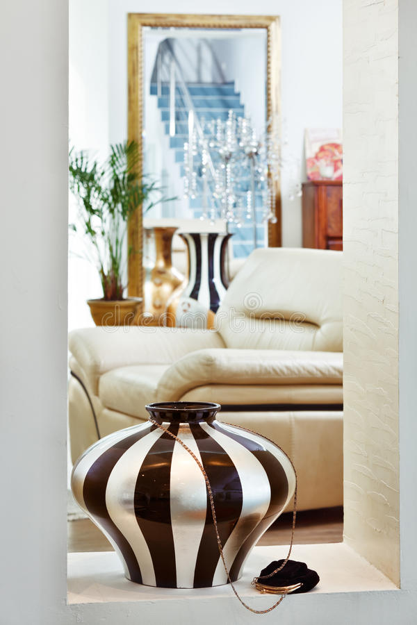 Part of art deco style drawing-room with vase. Part of modern art deco style drawing-room interior with striped vase royalty free stock photos