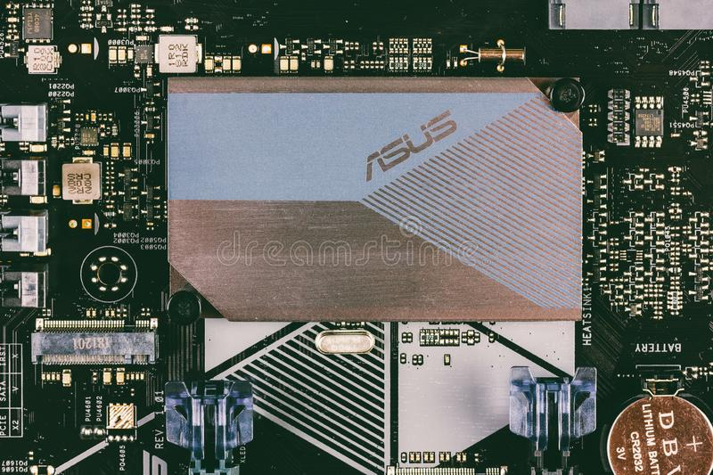 Part of ASUS motherboard with aluminum radiator chipset top view close-up. Maykop, Russia - November 9, 2018: part of ASUS motherboard with aluminum radiator royalty free stock photo