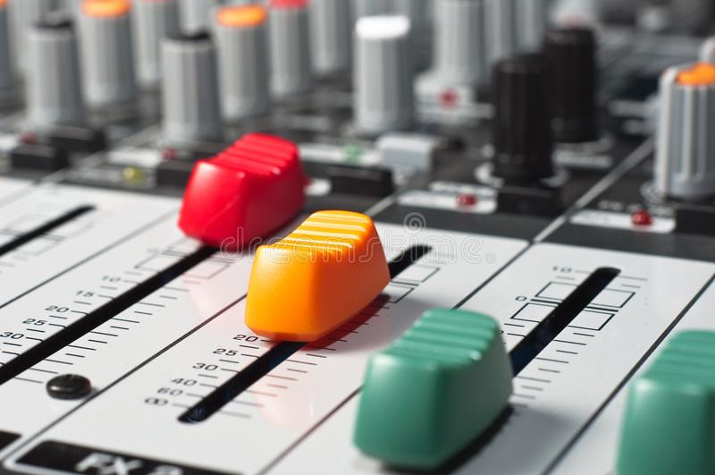 Part of an audio sound mixer. With buttons and sliders stock images