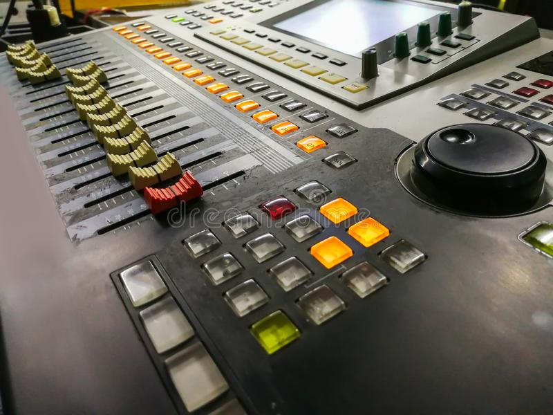 Audio Equipment, Push Button, Recording Studio, Radio, DJ. Part of an audio sound mixer with buttons and sliders. with shallow depth of field royalty free stock images
