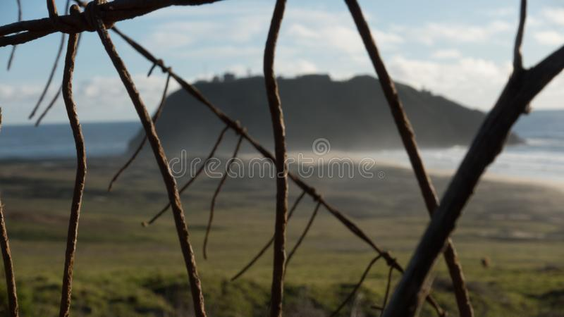 Barbed wire bulkheads the beach royalty free stock image