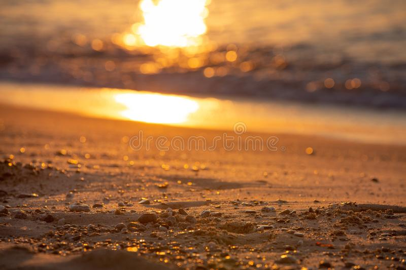 Part of beach and sea under sunrise color. Small depth of focus. Part of beach and sea under sunrise color. Toned. Small depth of focus stock images