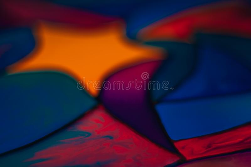 Part of a beautiful colorful stained glass background with a star image including yellow, red, blue, violet and pink royalty free stock photos