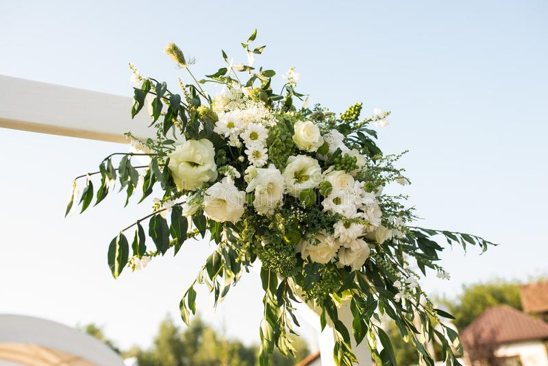 A part of beautiful wedding arch with fresh white flowers and download a part of beautiful wedding arch with fresh white flowers and greenery in the garden mightylinksfo