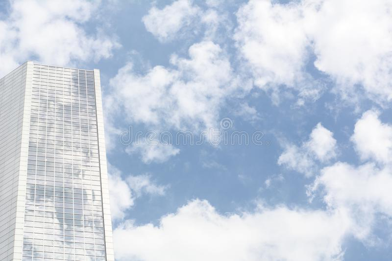 Part of big white building on the blue sky. With clouds stock image