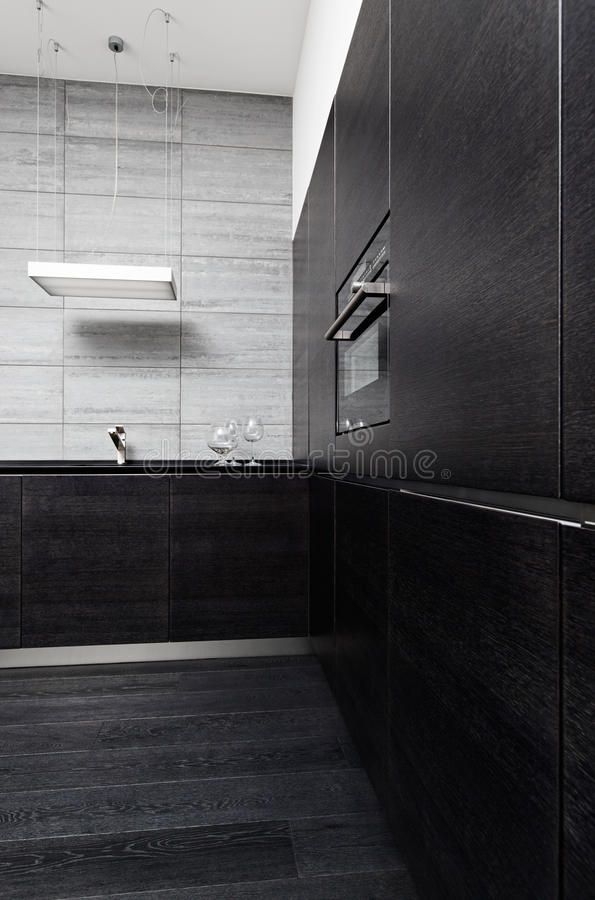 Part of black hardwood kitchen stock photo