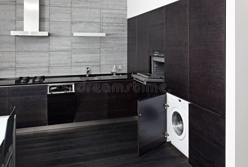 Part of black hardwood kitchen interior royalty free stock images