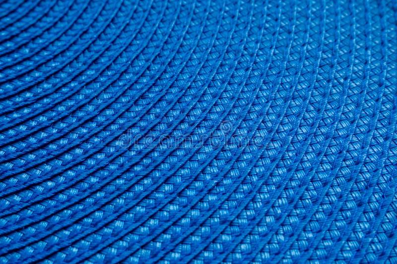 A part of blue round woven textile mat. Abstract background, selective focus stock photos