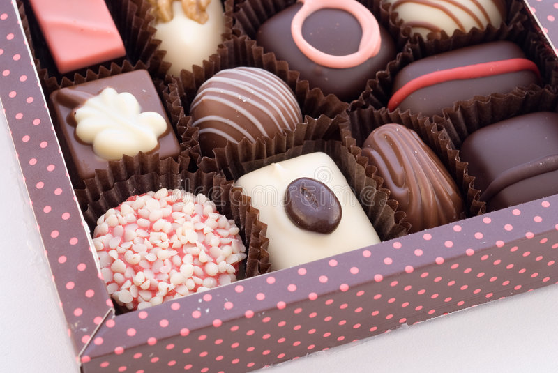 Part of box with chocolate bonbons. On white background stock images