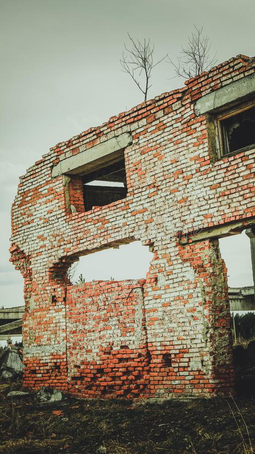 Part of a brick collapsed building in Russia. Detail royalty free stock photography