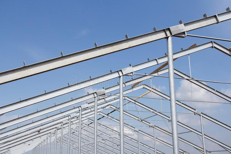 Part of the building structure of galvanized parts. Galvanized parts on a construction site in sunny weather. Installation of metal structures. Galvanized stock photo