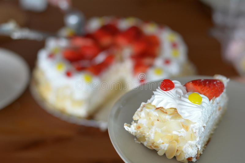 Part Of Cake With Fresh Strawberries And Decorations royalty free stock image