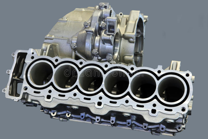 Part of car engine. With the transmission in a rugged aluminum enclosure royalty free stock images