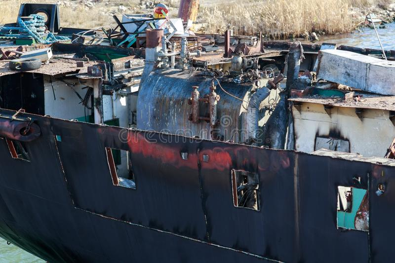 Part of the cargo ship in the process of demolition for scrap stock image