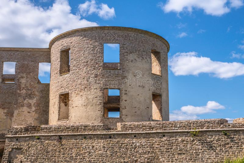 Corner part of the castle ruin of Borgholm. Part of the castle ruin of Borgholm in summer time with blue sky and white clouds and golden sunlight stock images