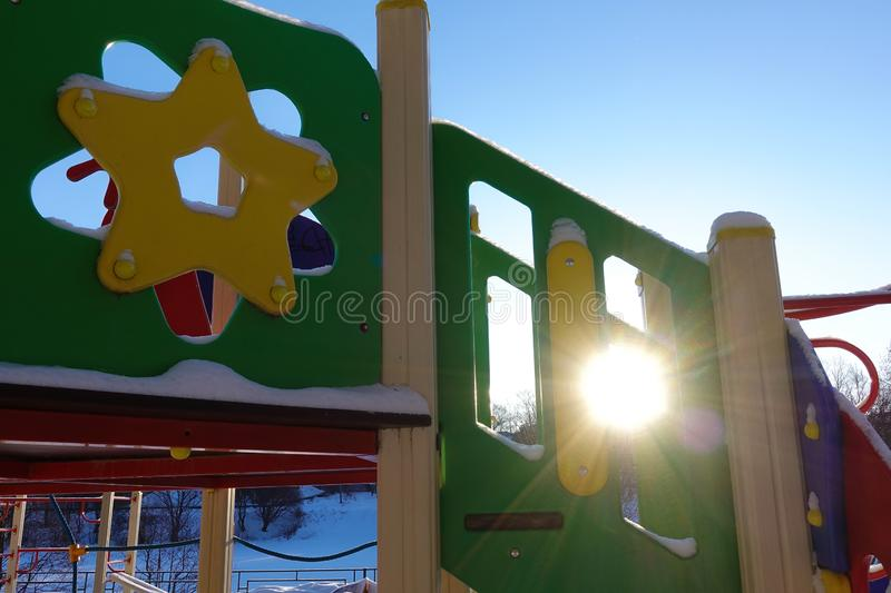 Part of the children`s playground close-up. Russia. The sun shines through the structure royalty free stock images