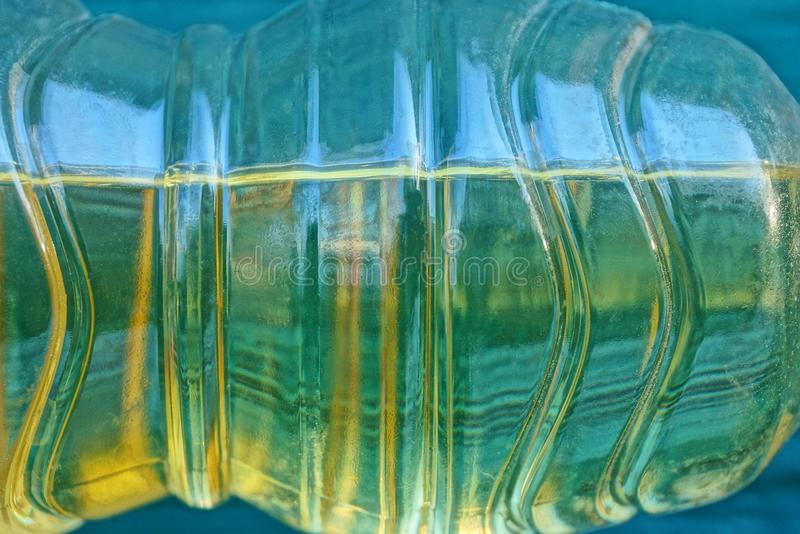 Part of a clear plastic bottle with yellow sunflower oil stock photo