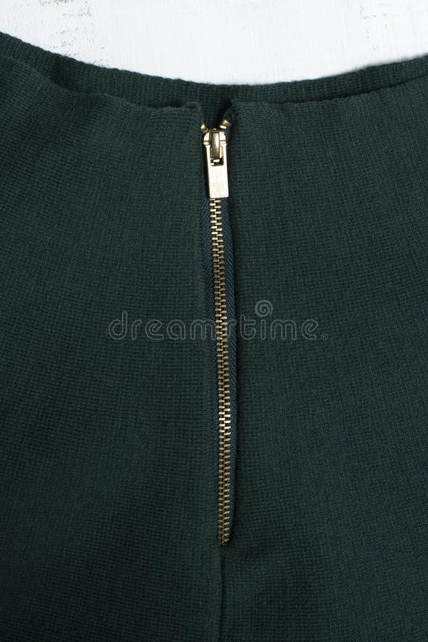 Part of dark green skirt with zipper. Fashion clothes.  stock photography