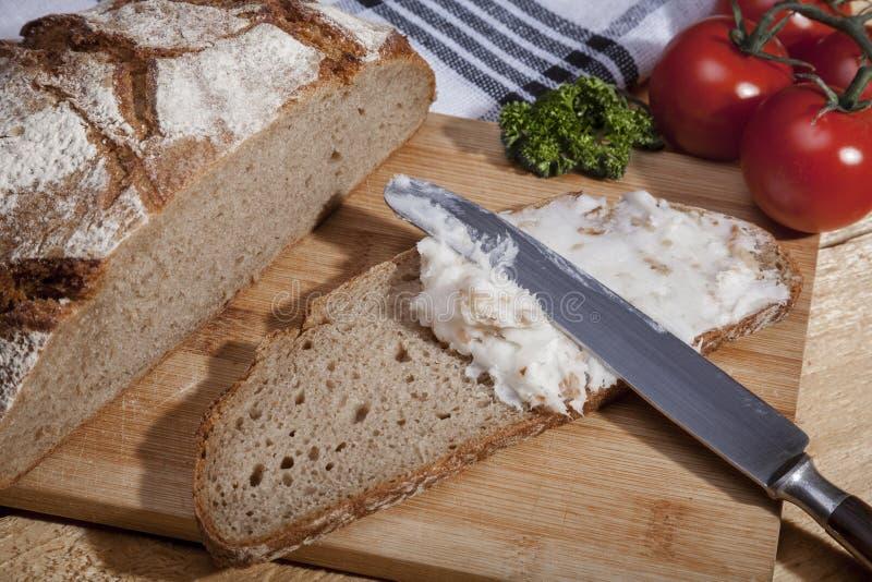 Part de pain avec le saindoux image stock
